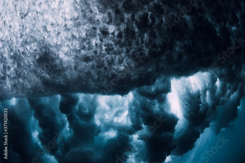 Fotografie, Obraz Crashing wave with foam and air bubbles underwater