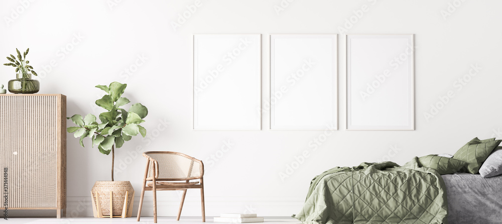 Fototapeta Fresh , comfortable bedroom with three vertical frames in bright design, poster mock up on white wall background