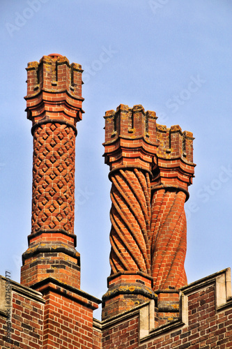 Canvastavla chimney pots on the roof of the house