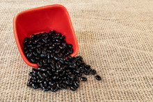 Black Beans In Red Pot On Jute...