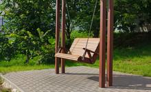 Wide Wooden Swing In The Yard,...