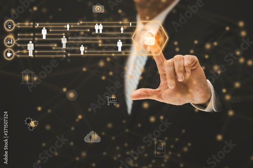 Obraz na plátně Businessman touching  line people network and line control in graph Screen Icon of a media screen, Business and Graphics line computing and technology concept