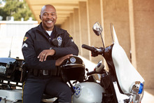 Portrait Of Police Officer Sitting On His Motorcycle