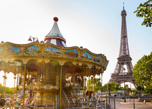 Carousel And Eiffel Tower Against Clear Sky During Sunrise, Paris, France