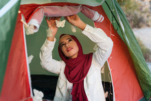 Young Tourist Woman Wearing Hijab Decorating A Tent
