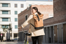 Young Woman Carrying Backpack ...