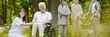 Leinwanddruck Bild Mature caregiver and elder man on the wheelchair