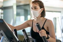 Woman Wearing Face Mask, Using...
