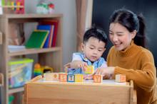 Asian Student In Preschool Use...