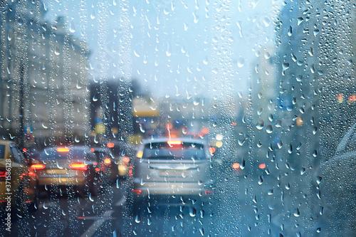 Obraz na plátně rain urban traffic cars, night view of the city, traffic flow of city lights abs