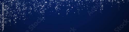 Fotografiet Beautiful snowfall Christmas background. Subtle fl