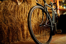 An Old Bicycle Is Placed By A Haystack In The Morning Light, Rem