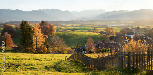 rural village Aidling in autumnal landscape, with view to mountain range bavarian alps