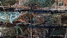 Crab Pots Stacked Up On The Shore In California