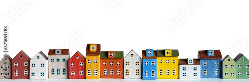 Row of wooden miniature colorful retro houses on white background Wallpaper Mural