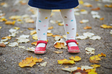 Toddler Girl In Red Shoes And ...
