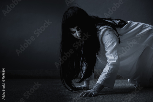 Horror woman ghost creepy crawling, halloween day concept Fototapet