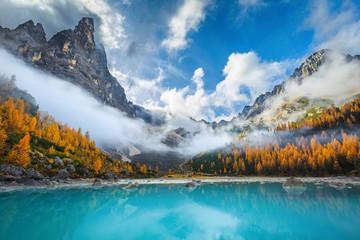 Amazing misty autumn scenery with lake Sorapis, Dolomites, Italy