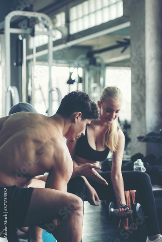 Fotomural Trainer training exercise with man and woman at the gym for healthy care and body slim