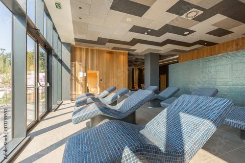 Hot stone mosaic sunbeds in wellness center Fototapet