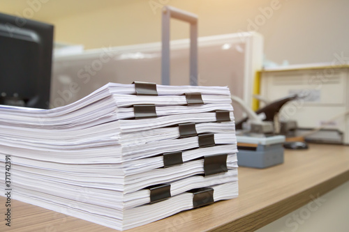 Fototapeta Pile of a lots paper and paperwork report or printout document on desk office stack up for work hard and information concepts