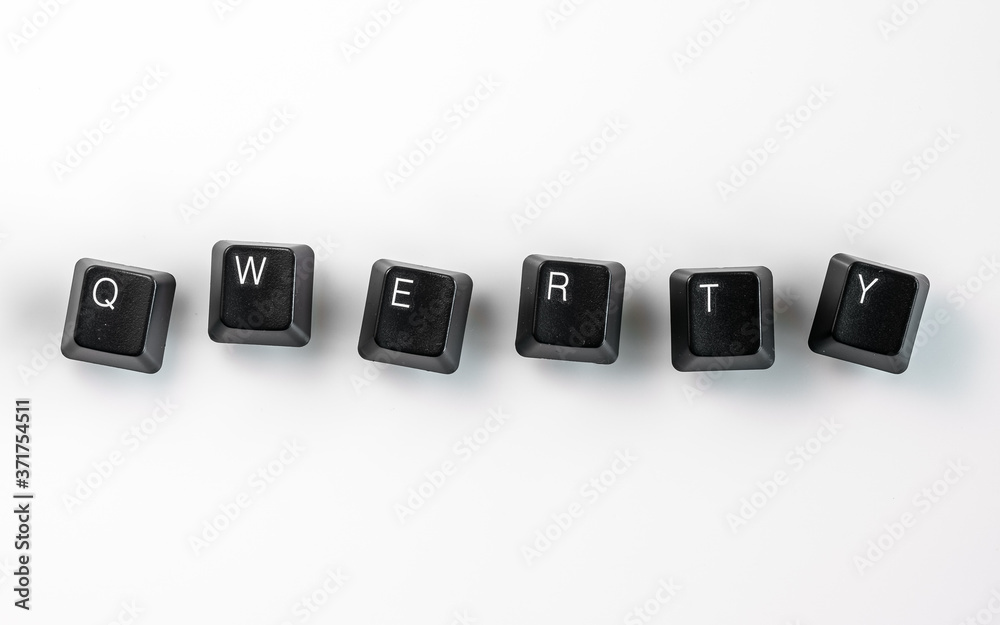 Fototapeta Computer keyboard keys spelling QWERTY, isolated on white background