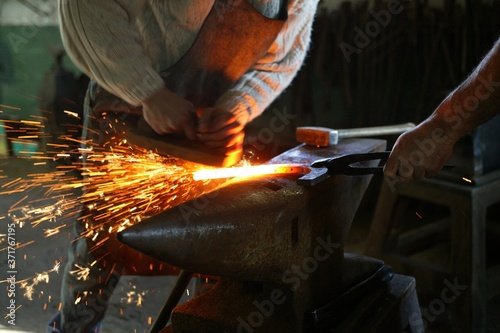 Blacksmith Smithy, Manufacturing Horseshoe from a Helm Bar Wallpaper Mural