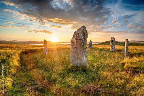Fototapeta Dranatic sunset over Ceann Hulavig stone circle on the Isle of Lewis