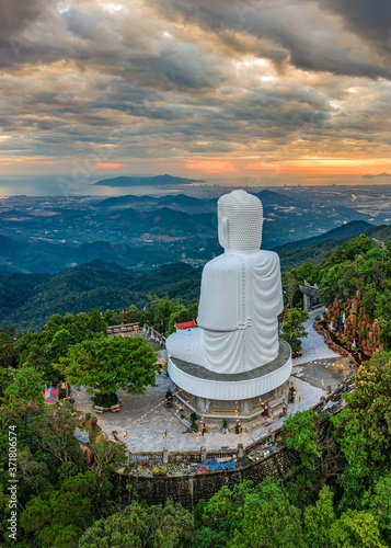 Fotografija Aerial view of Linh Ung pagoda near the Golden Bridge is lifted by two giant hands on Ba Na Hill in Da Nang, Vietnam