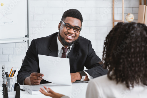 Fotografía Happy personnel manager and young job applicant on work interview at company off