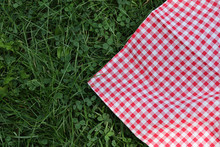 Background Plaid On Green Grass For Picnic