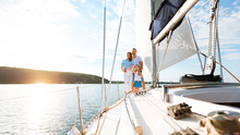 Family Relaxing On Yacht Enjoying Boat Ride Standing Outdoor, Panorama