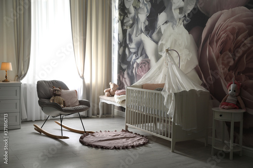 Baby room interior with stylish crib and floral wallpaper Wallpaper Mural