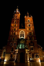 Old City Center View With Adam Mickiewicz Monument And St. Mary's Basilica In Krakow At Night