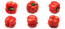 Red Bell Peppers On A White Background. High Quality Photo