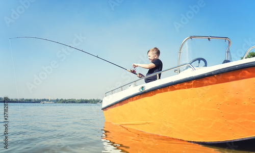 Obraz na plátně A boy on a fishing trip caught a fish