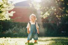 Cute Baby Boy Standing In Park...