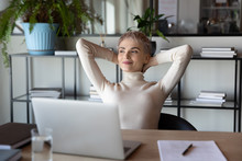 Distracted From Job Happy Peaceful Blonde Businesswoman Relaxing With Folded Hands Behind Head, Dreaming Of Future Challenges Or Planning Weekend, Satisfied With Good Job Done, End Of Workday.