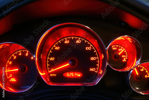 Slika na platnu The glowing red speedometer of a Pontiac G6 with emblems removed.