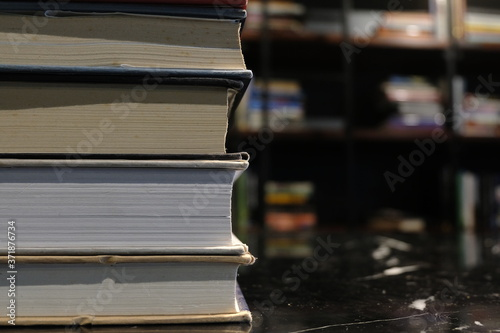 stack of old book in library concept Fototapeta