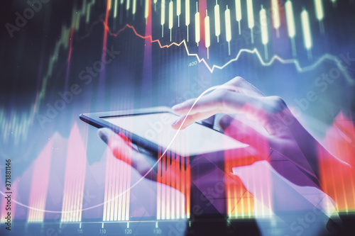 Fotografia Double exposure of forex chart sketch hologram and woman holding and using a mobile device
