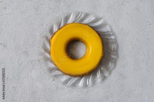 Fotografie, Obraz Quindão doce derivado do quindim tradicional do sul do Brasil, feito com gemas, açúcar e coco ralado