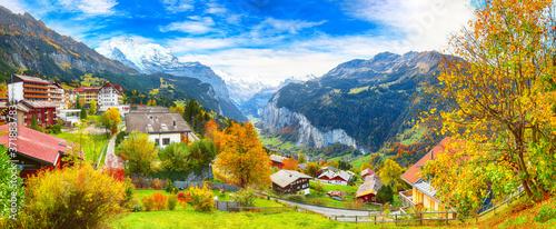 Fotografie, Obraz Stunning autumn view of picturesque alpine village Wengen