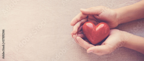 Fototapeta hands holding red heart, health care, love, organ donation, family insurance,CSR,world heart day, world health day, wellbeing, gratitude, be kind,be thankful concept obraz