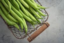 Raw Green Beans In Metal Basket