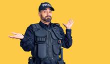 Young Hispanic Man Wearing Pol...