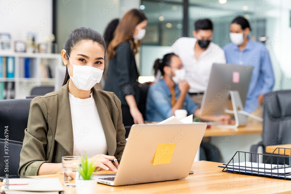 Fototapeta Portrait asian businesswoman working in new normal and social distance office