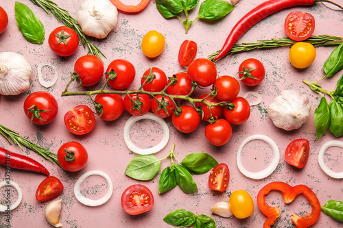 Leinwand Poster Composition with fresh cherry tomatoes, herbs and spices on color background