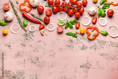 Foto Composition with fresh cherry tomatoes, herbs and spices on color background