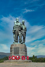 Famous Commando Memorial Near Spean Bridge, Scottish Highlands. This Is A Public Memorial To Remember The Service Of The Commandos. Taken On Sunny Day With Blue Sky.